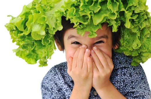 Kid holding salad hat